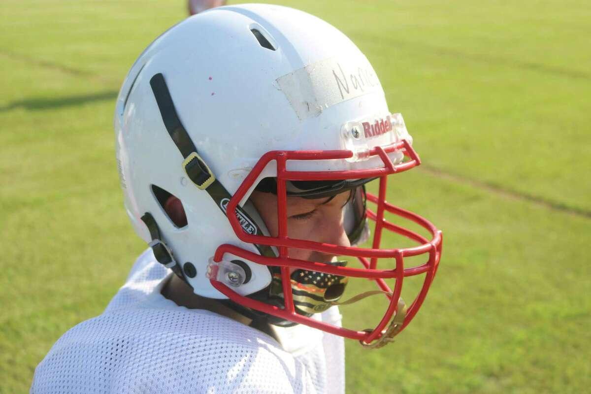 Deer Park Junior High seventh-grade player Kayden Nance watches teammates run a play during practice.