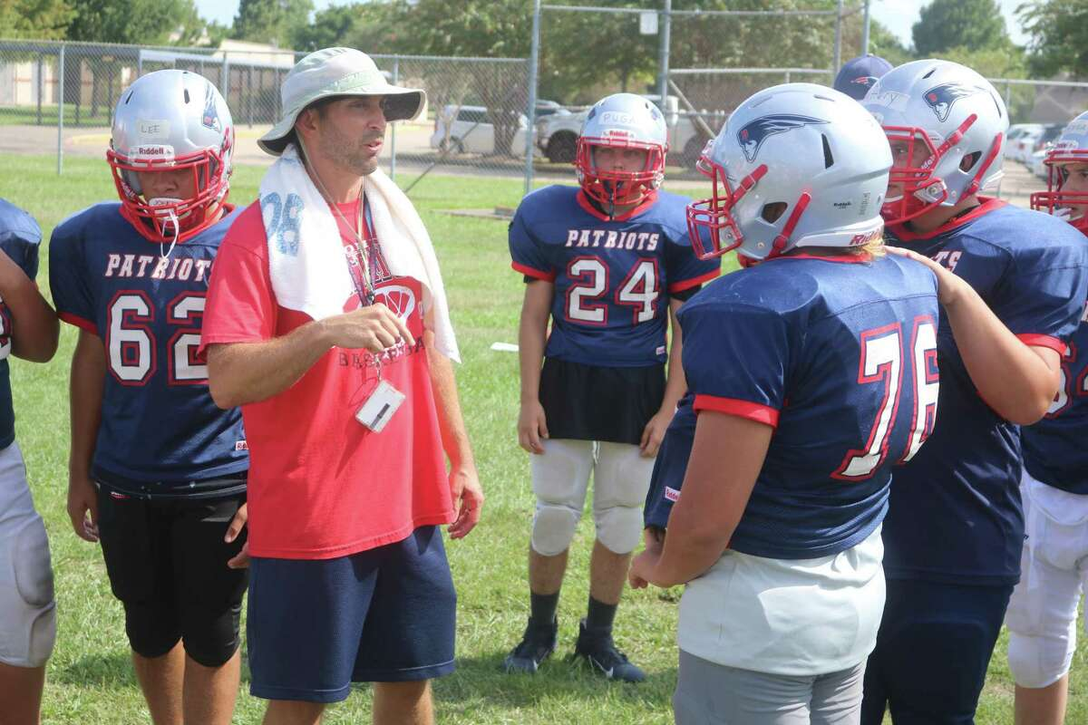 Bondy Intermediate coach Stephen Naron prepares for another drill with his eighth-graders during a workout.