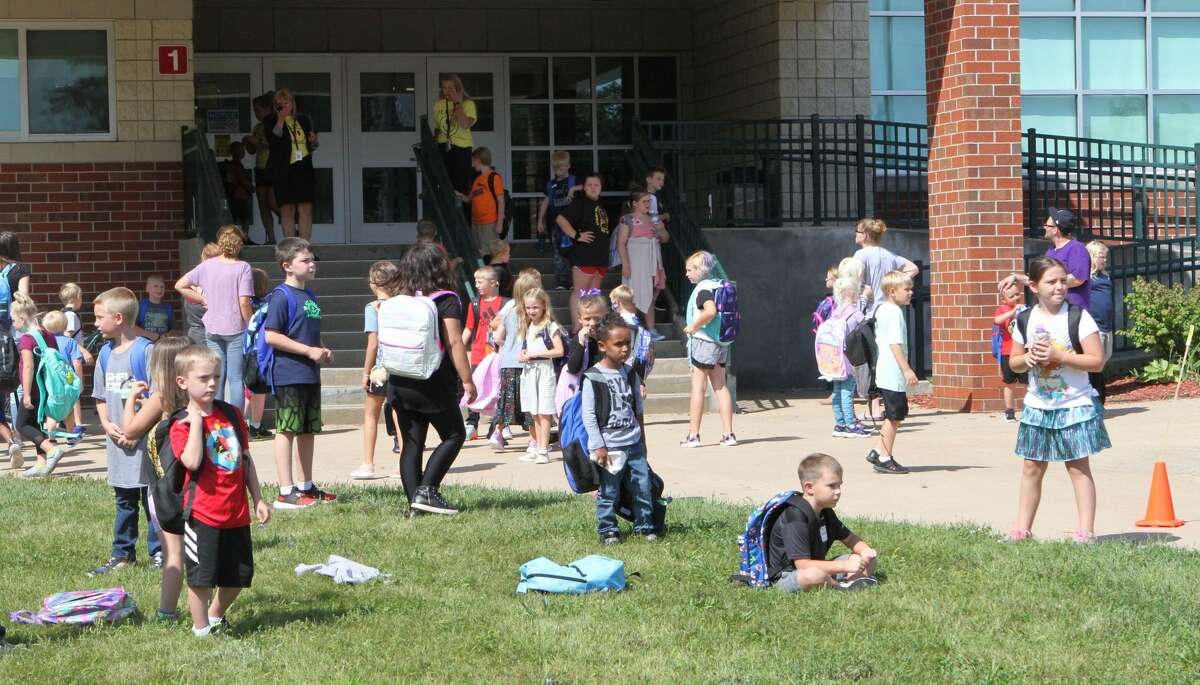 Students at Reed City's G.T. Norman Elementary School were greeted by parents, siblings and loved ones upon their early dismissal from Wednesday's first day of school.
