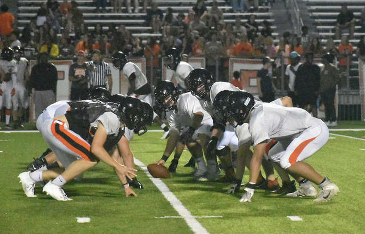 The Edwardsville offensive line prepares for the next play during the Orange and Black Scrimmage on Friday inside the District 7 Sports Complex.