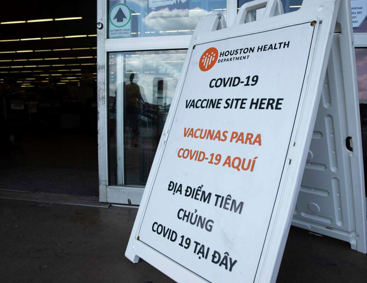 A multi-language Houston Health Department COVID-19 sign is plaed outside at a Food Town vaccine site Tuesday, Aug. 24, 2021, in Houston.