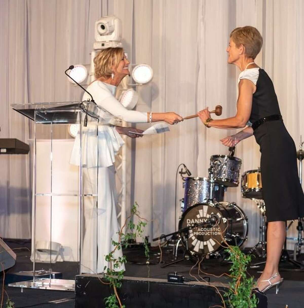 The Woodlands Area Chamber of Commerce held its 43rd Annual Chairman's Ball Saturday night at The Woodlands Waterway Marriott Hotel & Convention Center. Jeff Garrett and Linda Nelson were celebrated as the outgoing chairman. Julie Ambler was welcomed as the incoming chairman of the Chamber. Nelson is pictured handing over the gavel to Amber at Saturday's ball.