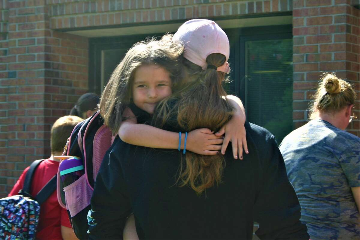 Brookside Elementary students report they had a successful first day back at school for the 2021-22 school year as they are greeted by parents during dismissal.