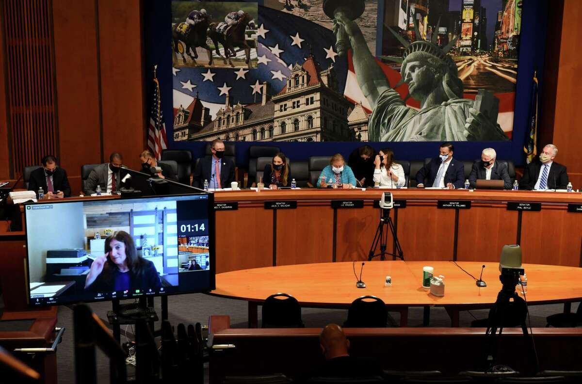 Former Joint Commission on Public Ethics (JCOPE) commissioner Julia Garcia, lower left, offers testimony during a public hearing on the state?•s system of ethics oversight and enforcement on Wednesday, Aug. 25, 2021, at the Legislative Office Building in Albany, N.Y. .