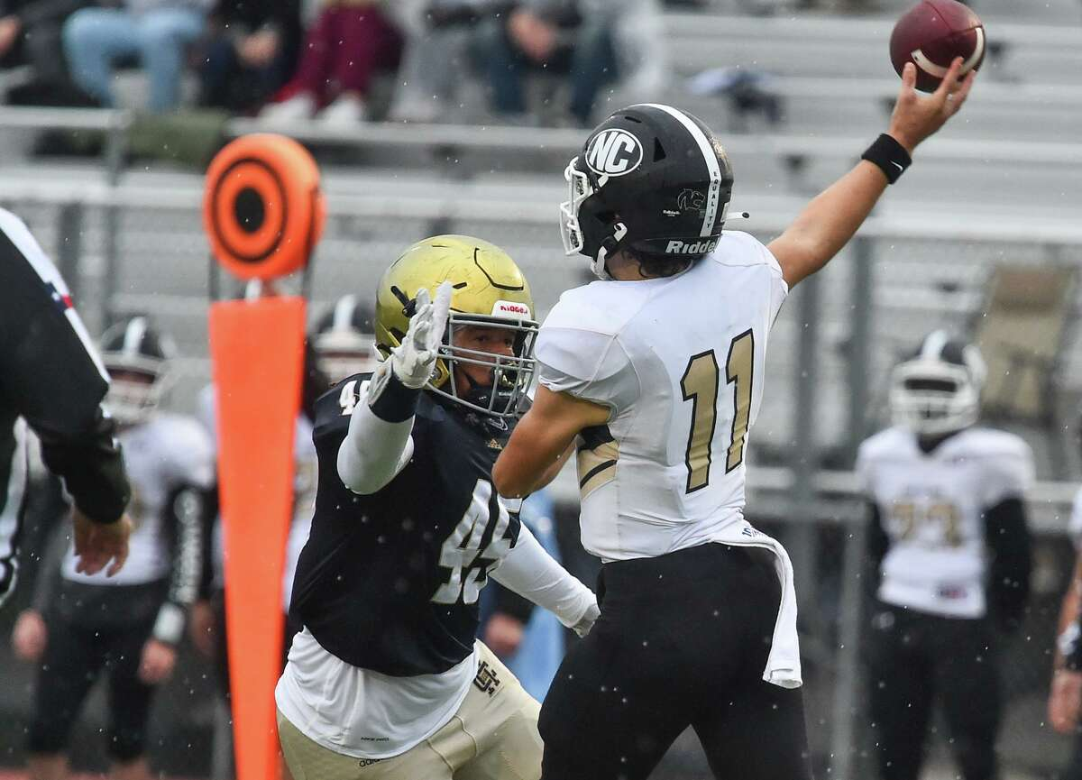 Holy Cross' Amir Ali puts pressure on Houston Northland Christian quarterback Billy Eaton during their TAPPS playoff game in 2020 at the Wheatley Heights Sports Complex.