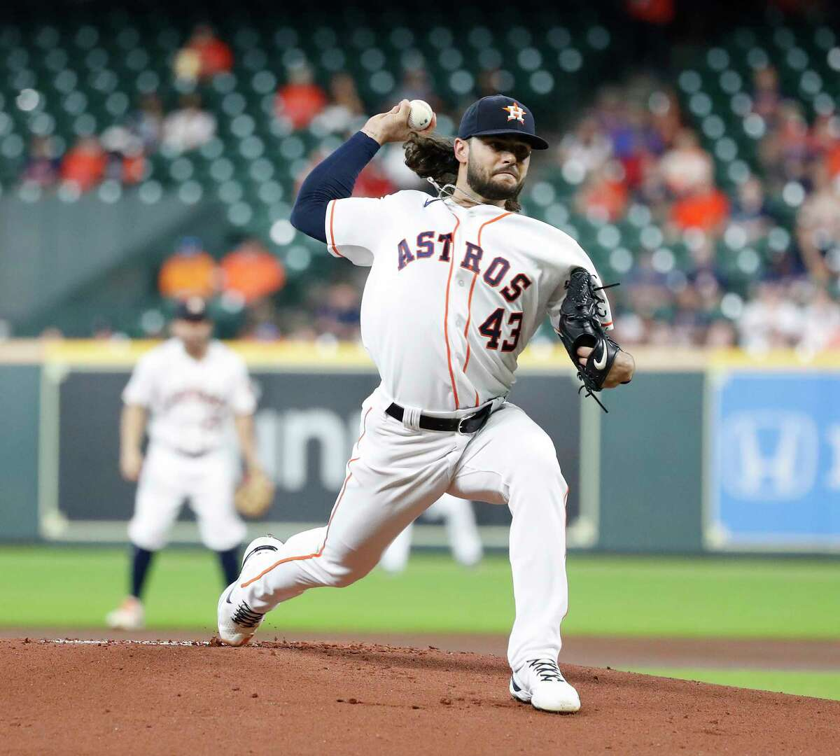 Houston Astros starting pitcher Lance McCullers Jr. (43) pitches during the first inning of an MLB baseball game at Minute Maid Park, Wednesday, August 25, 2021, in Houston.