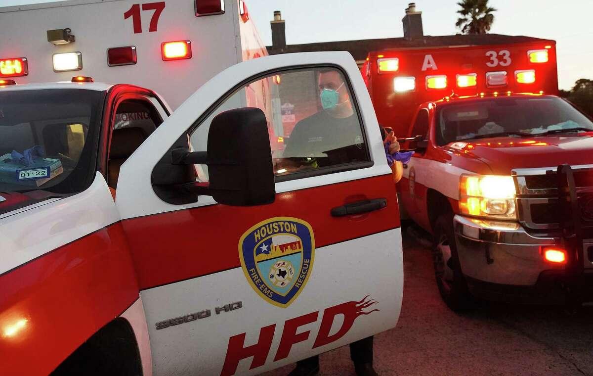 Houston Fire Dept. paramedic Josh Walls prepares to respond to a call in Houston on Thursday, Aug. 19, 2021.