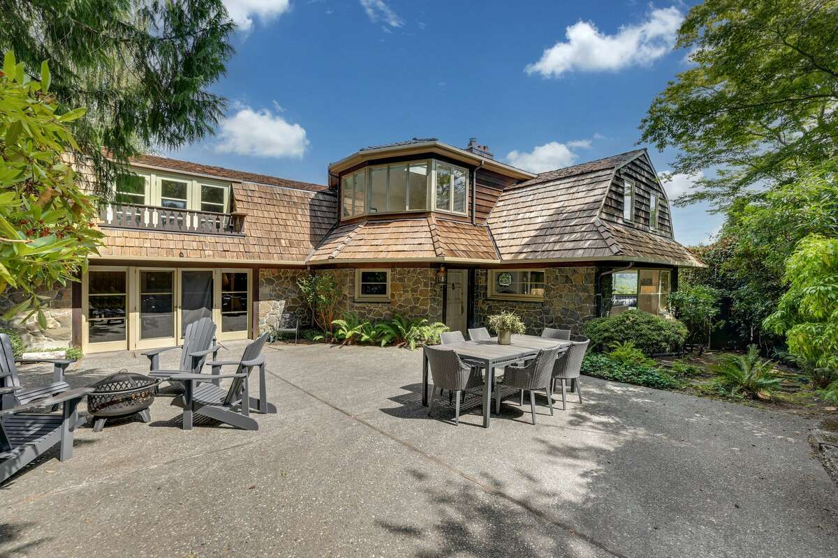 The castle-like Tudor offers a huge patio for taking in the setting and views.