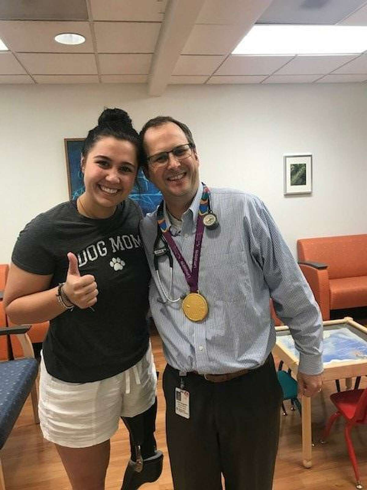 Jillian Williams with Dr. Aaron Sugalski, a pediatric oncologist with the Mays Cancer Center, home to the UT Health San Antonio MD Anderson. Sugalski sees patients at University Hospital, which is a facility of University Health, where Williams received many rounds of chemotherapy.