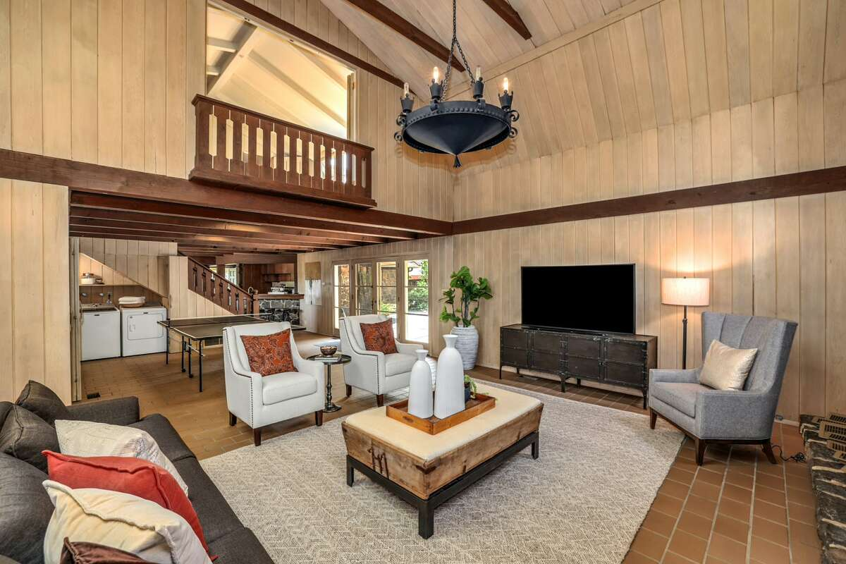 The home is multi-level, with multiple flexible rooms: bedroom, den, office, family room. A balconetadds to the Tudor romance.