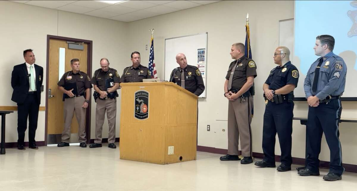 (At the podium) Mecosta County Sheriff Brian Miller speaks Wednesday regarding a human trafficking sting operation that took place earlier this summer.