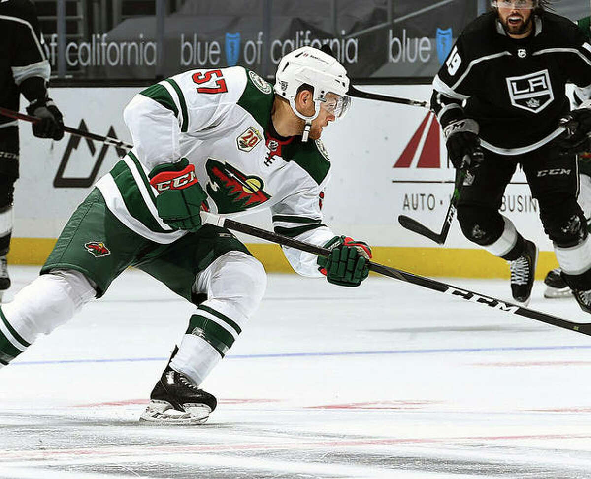 Alton native Dakota Mermis of the Minnesota Wild takes a shot during a game last season against the Los Angeles Kings. Mermis signed a two-year contract extension during the offseason and will leave for preseason training camp in September.