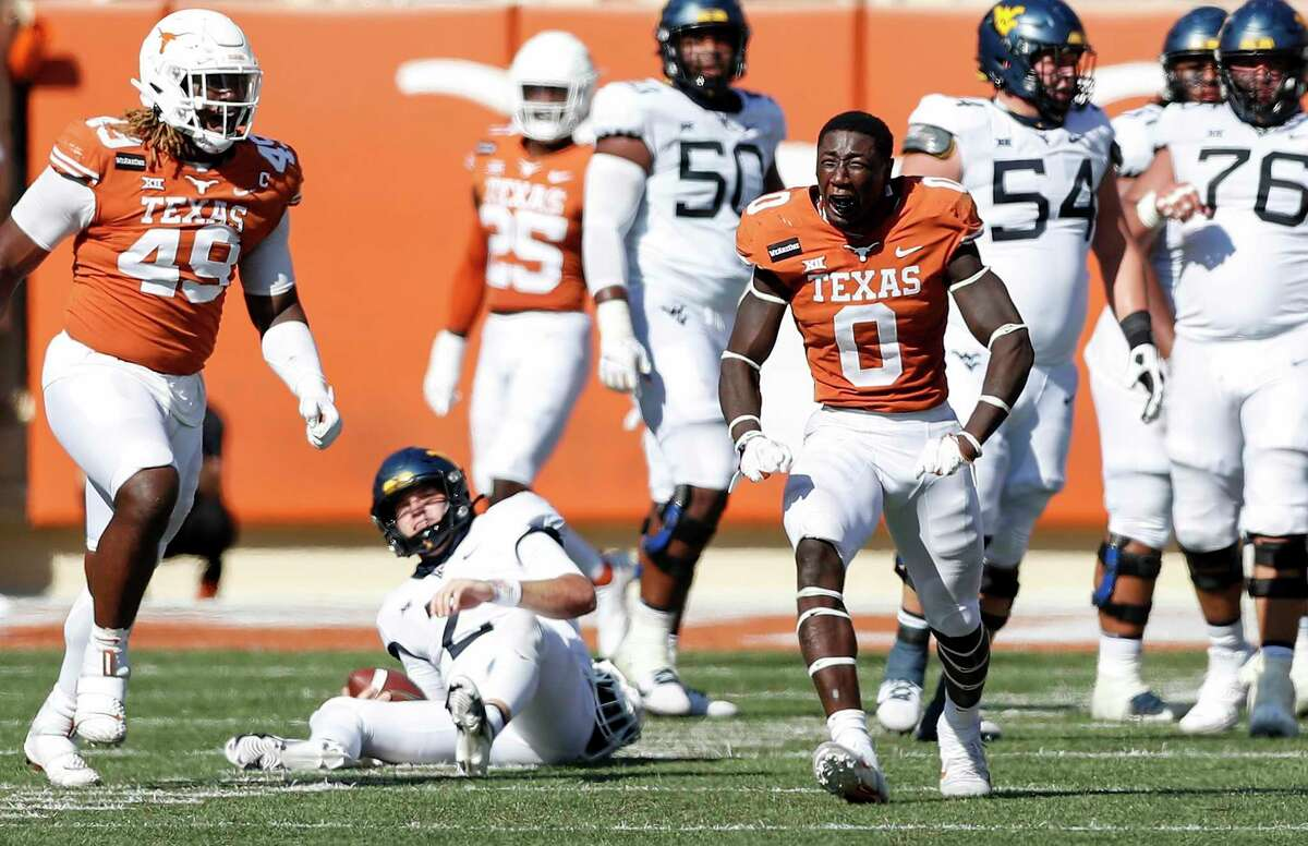 DeMarvion Overshown #0 of the Texas Longhorns reacts after sacking Jarret Doege #2 of the West Virginia Mountaineers in the third quarter at Darrell K Royal-Texas Memorial Stadium on November 07, 2020 in Austin, Texas. (Photo by Tim Warner/Getty Images)