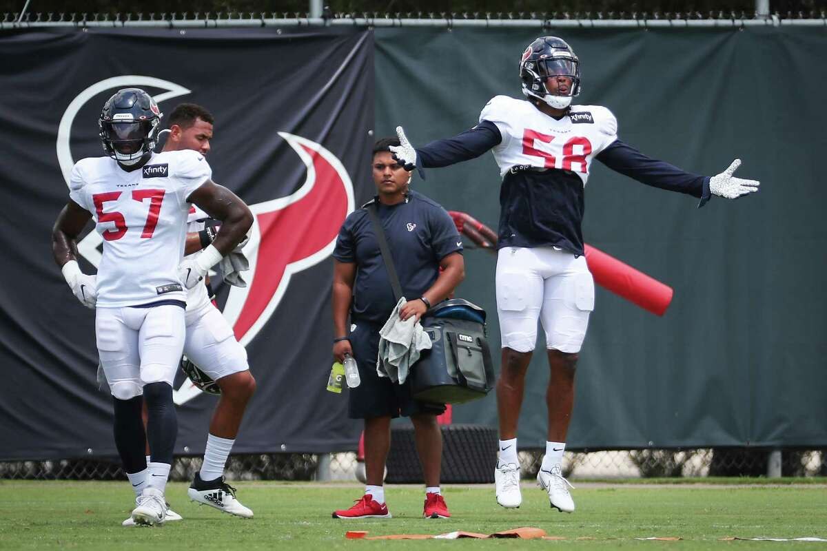 Houston Texans linebackers Kevin Pierre-Louis (57) and Christian Kirksey (58) work out during an NFL training camp football practice Wednesday, Aug. 25, 2021, in Houston.