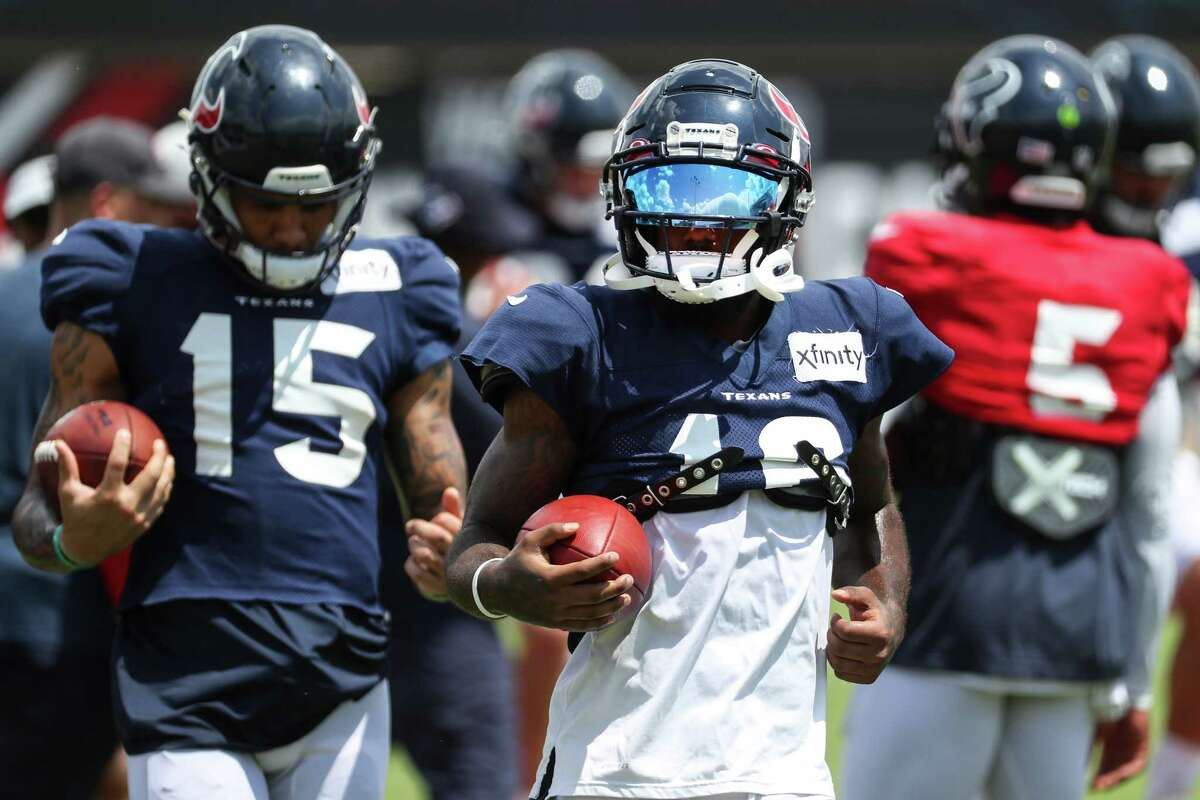 Houston Texans wide receivers Keke Coutee (16) and Chris Moore (15) run drill sduring an NFL training camp football practice Wednesday, Aug. 25, 2021, in Houston.