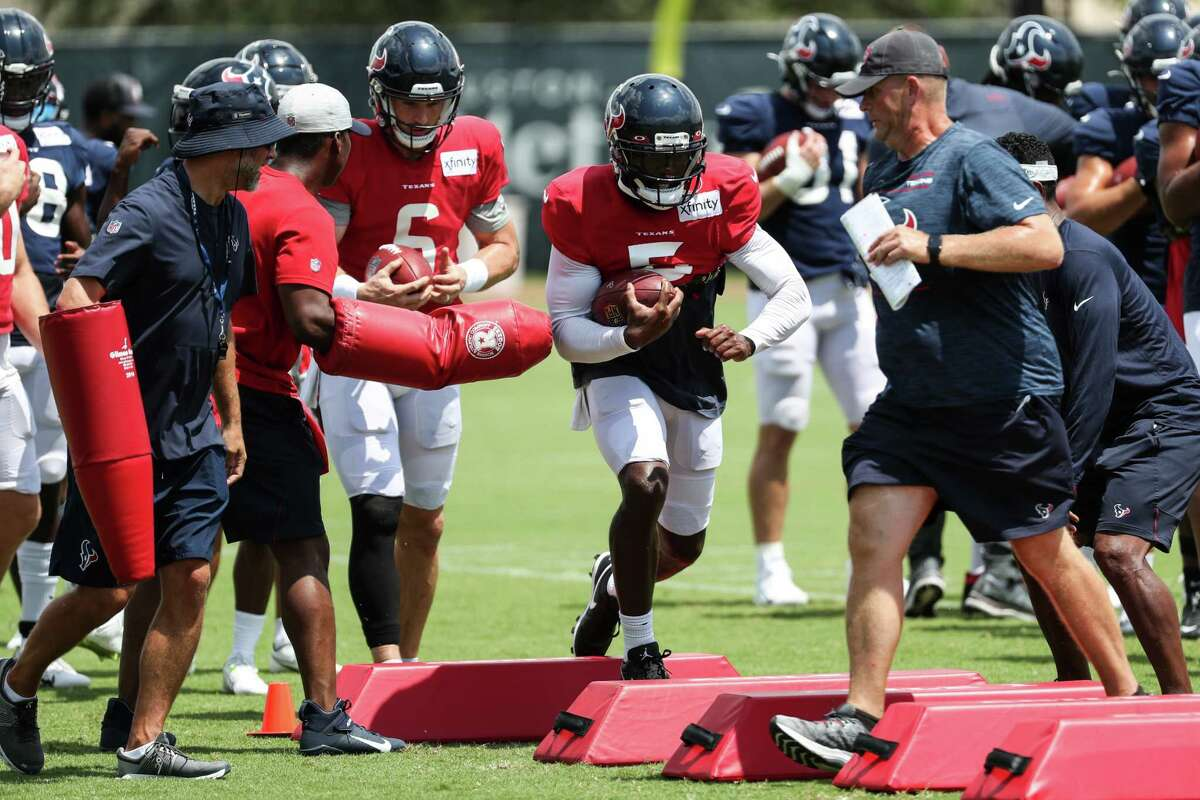 Houston Texans quarterback Tyrod Taylor (5) runs a drill during an NFL training camp football practice Wednesday, Aug. 25, 2021, in Houston.