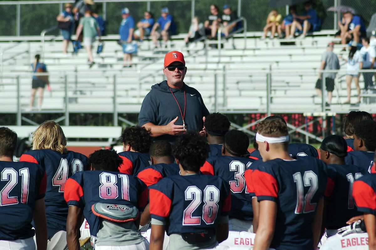 Dawson football coach Mike Allison speaks to the Eagles prior to a scrimmage against Friendswood last week at Dawson High School.