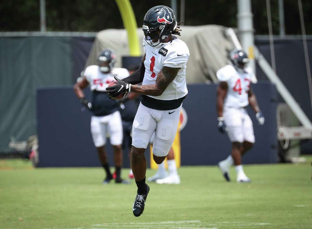 Houston Texans cornerback Lonnie Johnson Jr. (1) leaps to make a catch during an NFL training camp football practice Wednesday, Aug. 25, 2021, in Houston.
