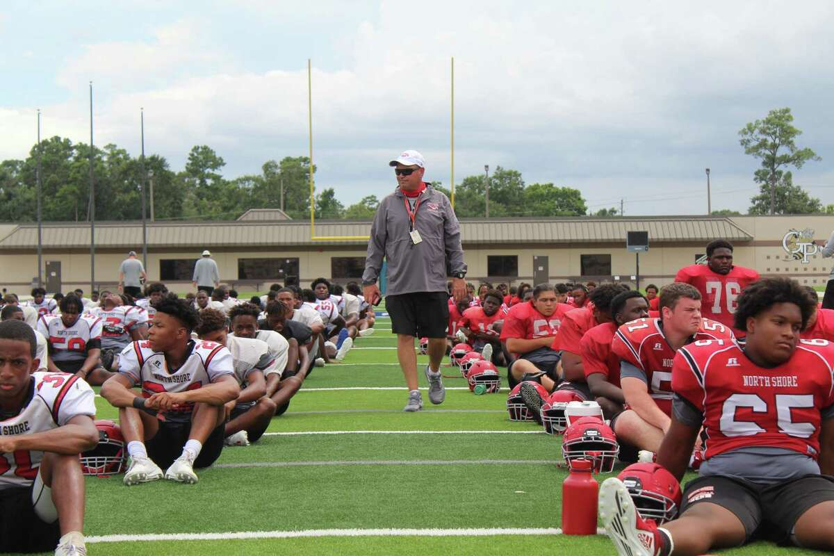 North Shore coach Jon Kay talking to his Mustangs before the start of practice during fall camp.