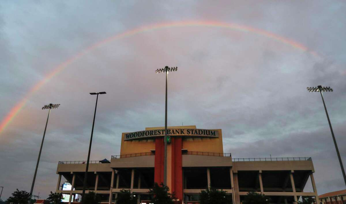 A rainbow is seen before a non-district high school football game at Woodforest Bank Stadium, Thursday, Oct. 8, 2020, in Shenandoah.