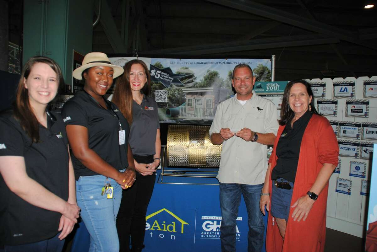 From left are Emilee Proctor, HomeAid; Kirsten Robbins, HomeAid; Tanya Rizzo, Legend Homes; Kevin Morse, Legend Homes and Carole Brady, HomeAid. All of them were on hand as the winning ticket for the Union Station Playhouse was drawn at Minute Maid Park.