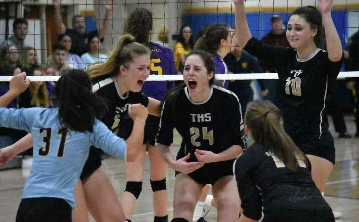 Trumbull celebrates after winning the Class LL girls volleyball state championship against Westhill on Saturday in East Haven. Story on page A7.