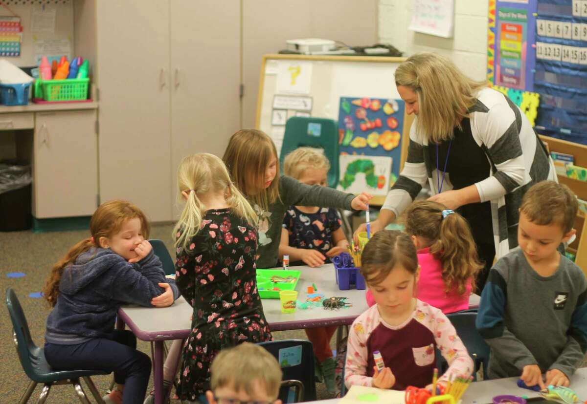In this file photo, students in Betsy Neph's preschool class at Onekama Consolidated Schools make molds of bugs using playdough and design their own bugs using construction paper on April 16. Superintendent Gina Hagen said the district's preschool and after-school programs are full.