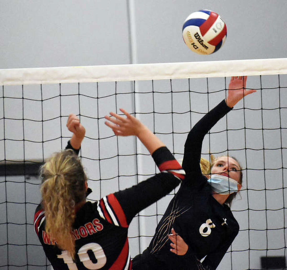 Father McGivney junior Aislin Hall goes up for a kill attempt during the first game against Granite City in the Roxana Tournament on Monday in Roxana.