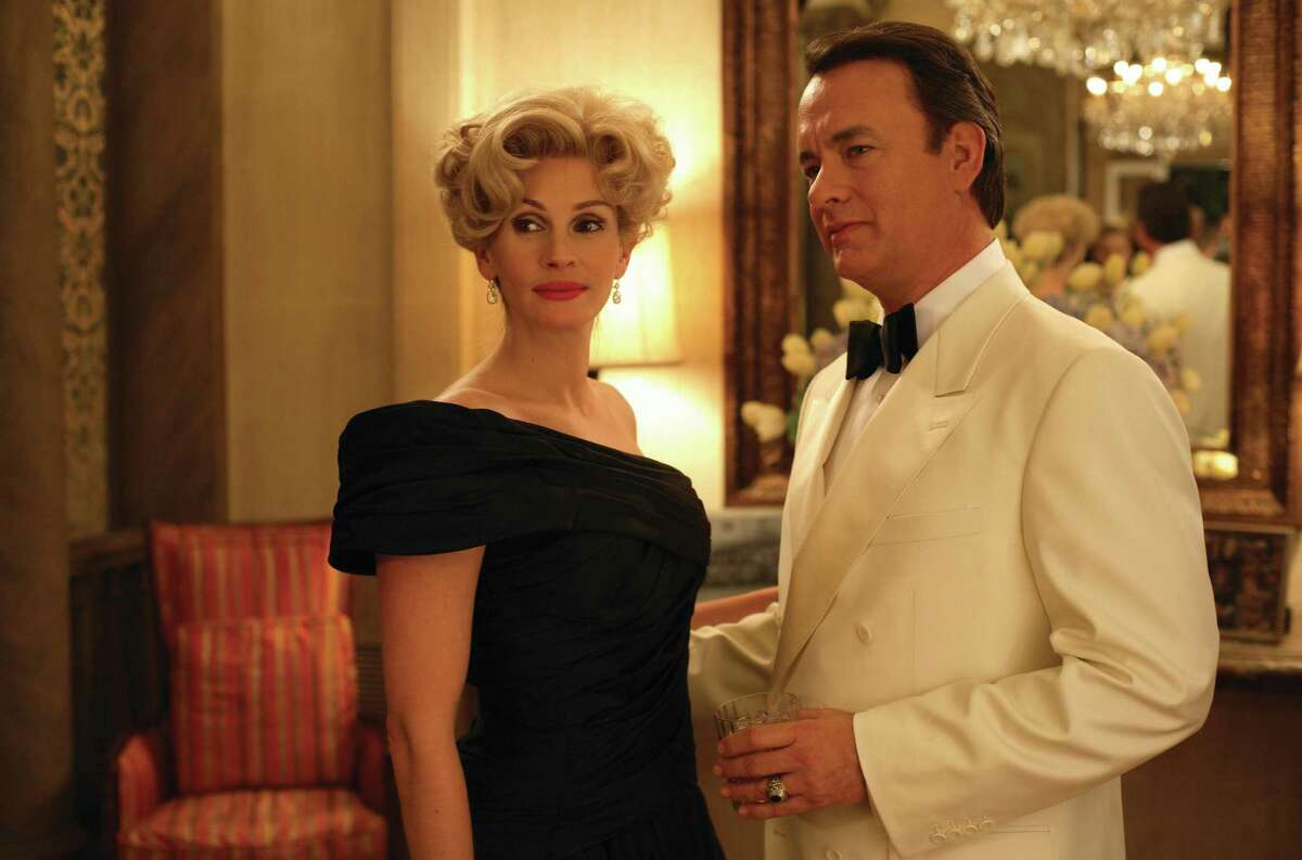 """Houston philanthropist Joanne Herring (JULIA ROBERTS) and Congressman Charlie Wilson (TOM HANKS) in the film that tells the raucous true story of the largest covert operation in history: """"Charlie Wilson's War."""""""