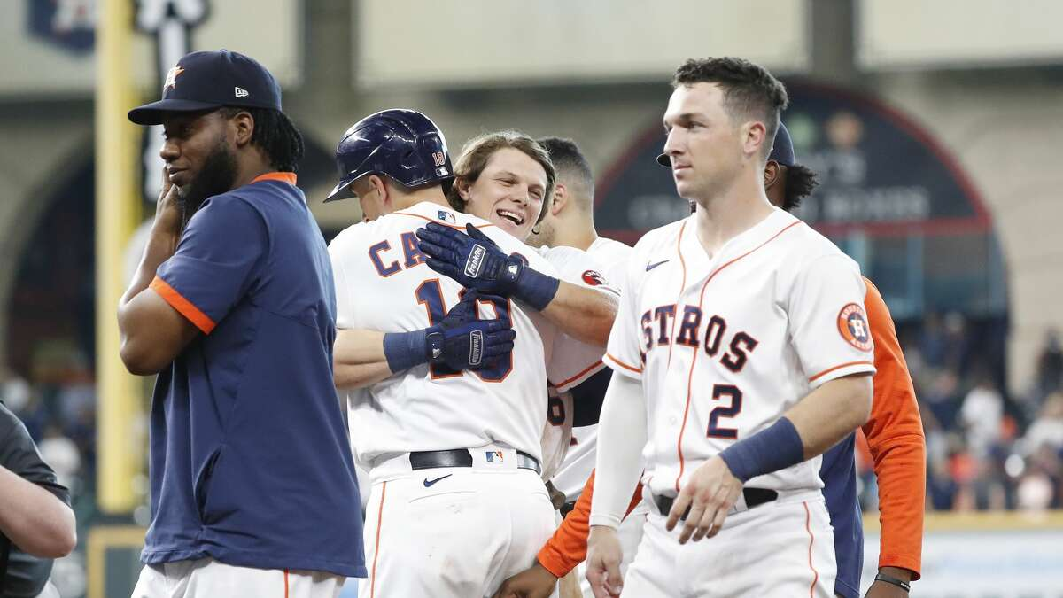 Houston Astros Jake Meyers (6) celebrates with Jason Castro after his walk-off fielder's choice during the tenth inning of an MLB baseball game at Minute Maid Park, Wednesday, August 25, 2021, in Houston.