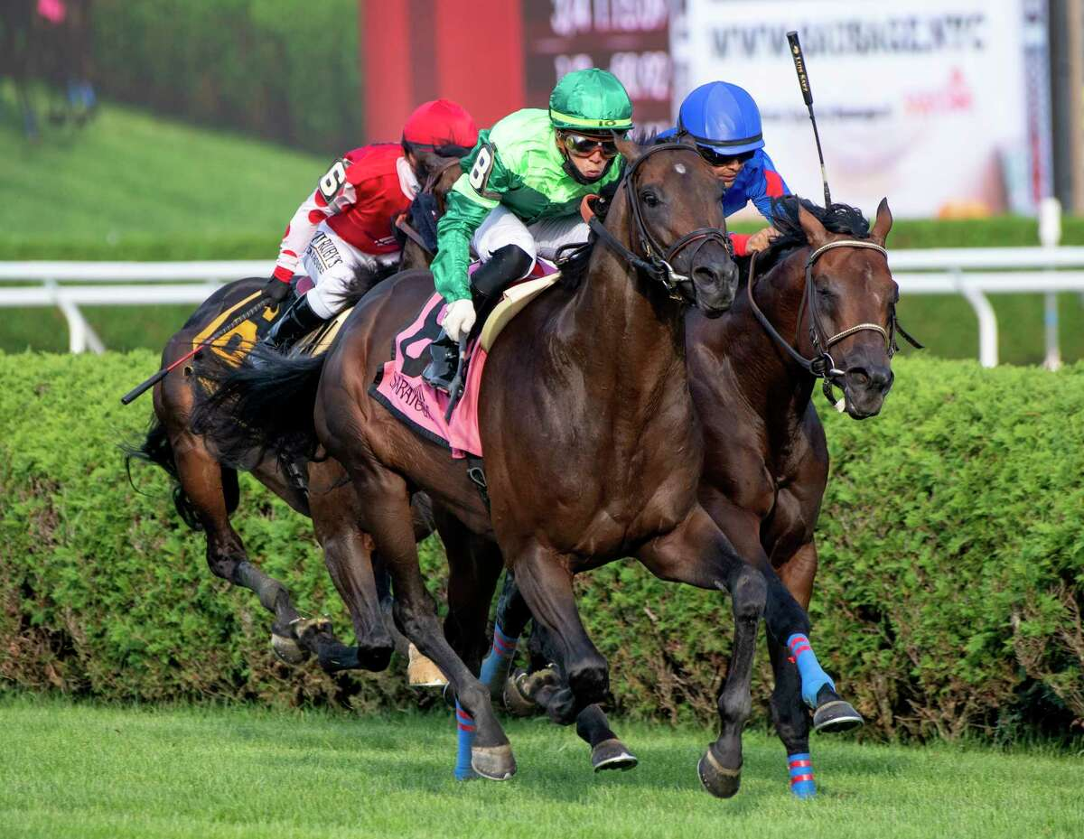 Serve the King, left, with jockey Irad Ortiz Jr., outduels Ry's the Guy, with jockey Luis Saez, to the wire to win the 17th running of the John's Call at Saratoga Race Course on Wednesday, Aug. 28, 2021, in Saratoga Springs, N.Y.