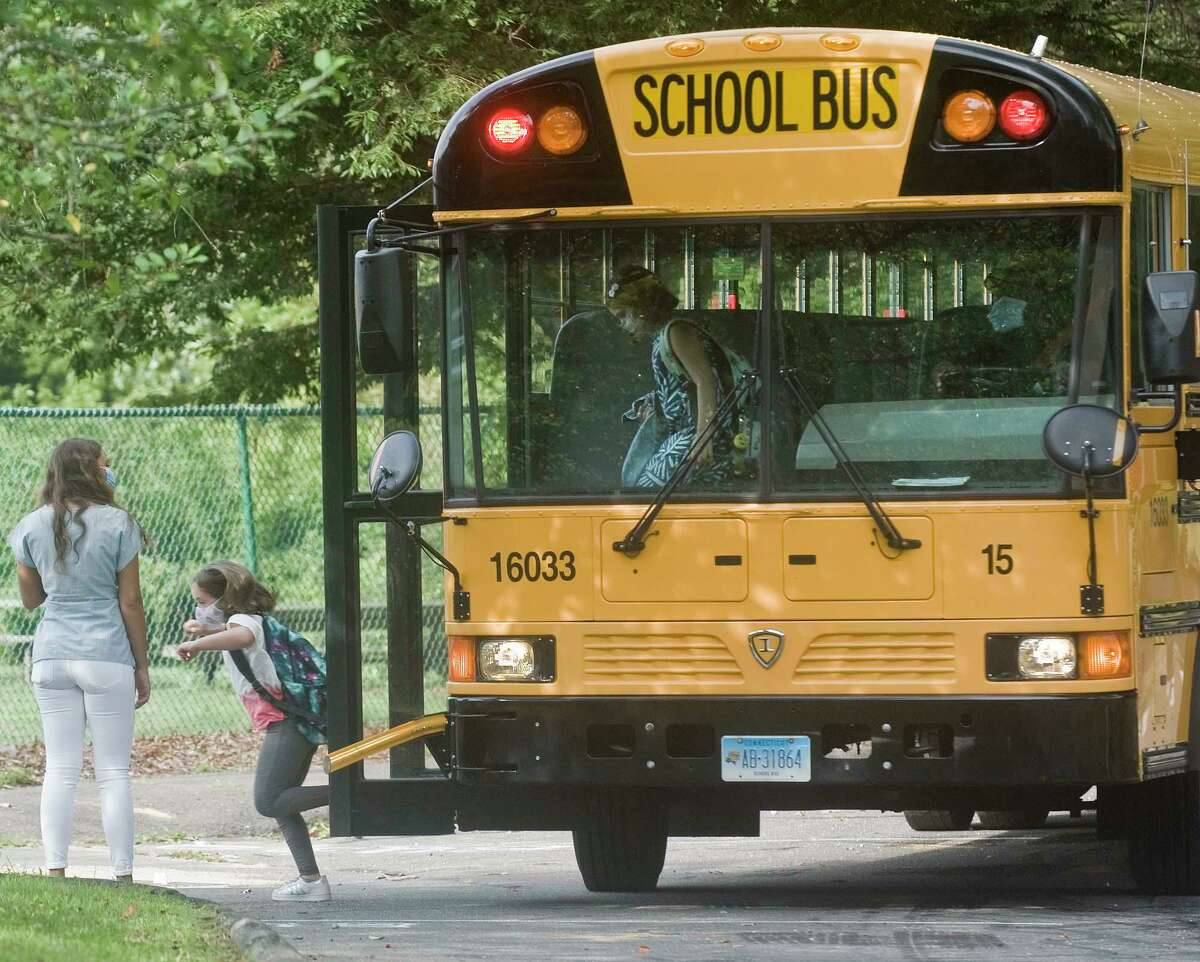 Children arrive for the first day of school at Coleytown Elementary School. Tuesday, Sept. 8, 2020