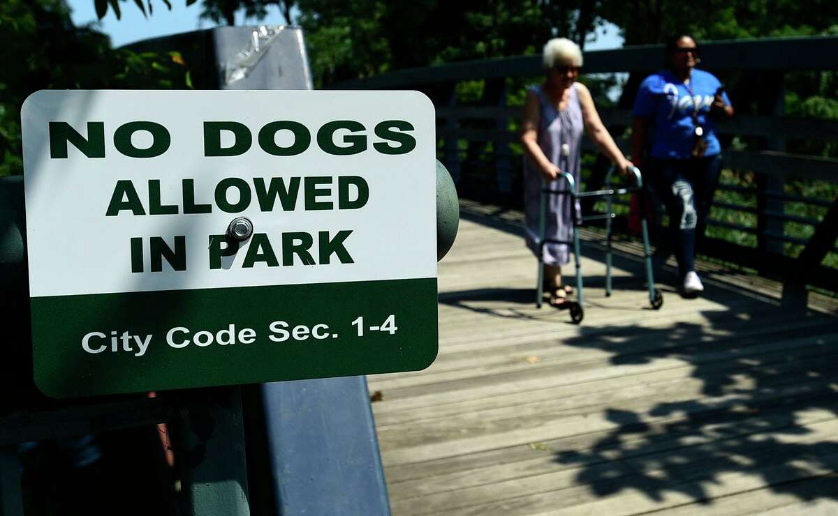 People walk in Oyster Shell Park Wednesday, August 25, 2021, in Norwalk, Conn. Loose dogs and increase in dog poop have become issue with residents.
