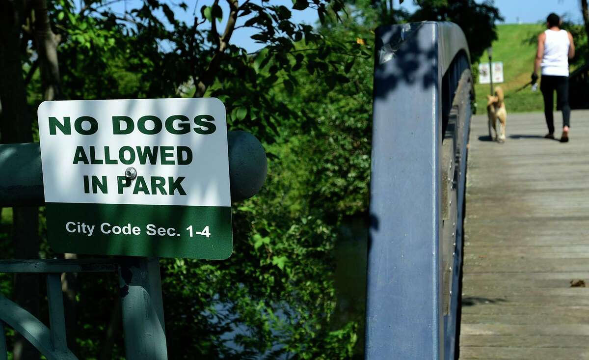 """""""No dogs allowed"""" signs have now been posted in about 80 percent of Norwalk's parks."""