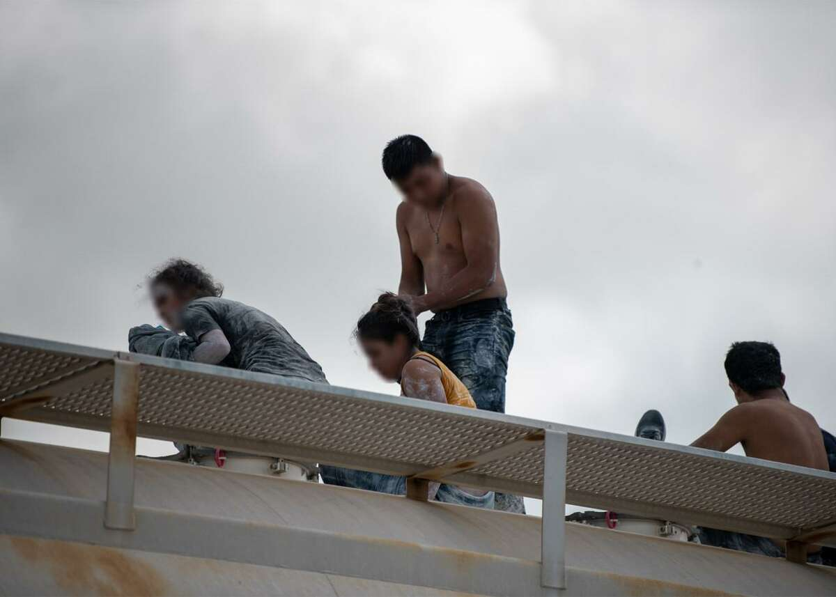 Several migrants were found covered in powdered clay during a human smuggling attempt.