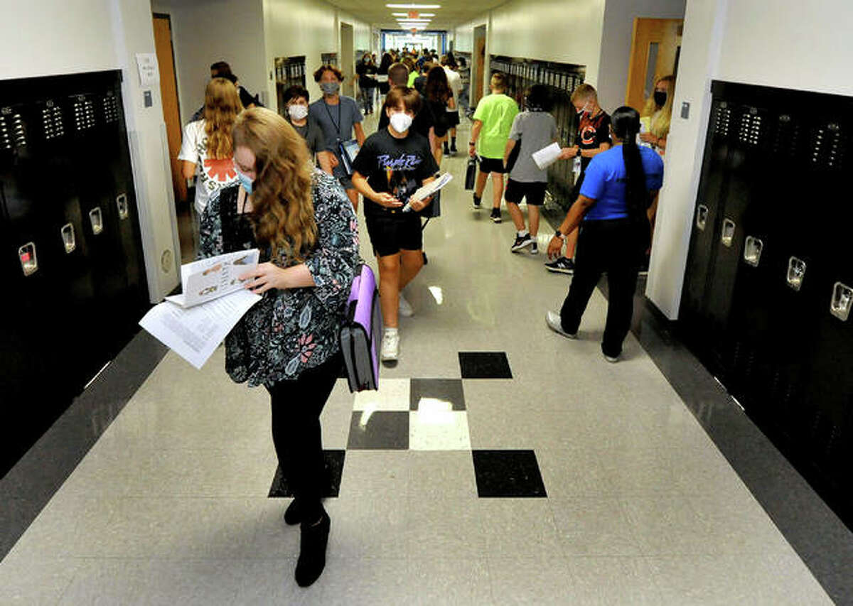 Students walk through a Liberty Middle School hallway as they change classes during this year's first day of school.