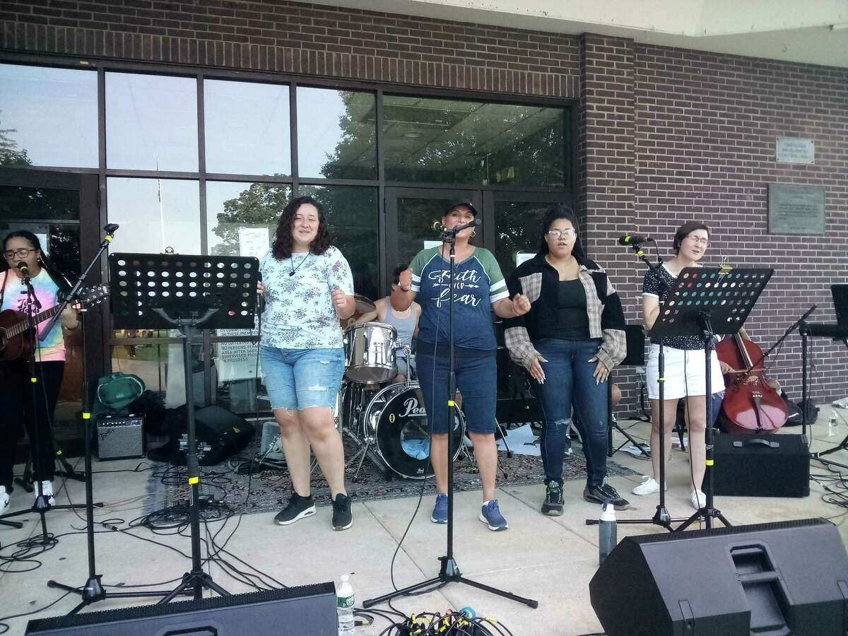 Residents brought their families to Coe Memorial Park Wednesday afternoon for Celebrate Belonging, a chance to meet nonprofits and service organizations while enjoying food, live music and activities. The Live Ministries' band performed, led by the Rev. Michelle Turnbull, second from left.