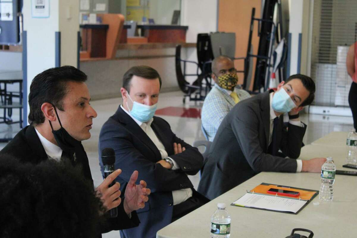 U.S. Sen. Chris Murphy, Middletown Mayor Ben Florsheim, Middletown Superintendent Michael Conner and Chief Academic Officer of Middletown Public Schools Alberto Vazquez Matos listen to students and staff talk about race in education.