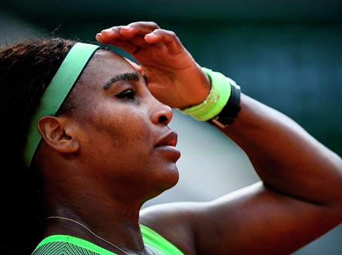 Serena Williams of the U.S. reacts as she plays against Kazakhstan's Elena Rybakina during their women's singles fourth round tennis match on Day 8 of The Roland Garros 2021 French Open tennis tournament in Paris on Sunday, June 6, 2021. (Christophe Archambault/AFP/Getty Images/TNS)