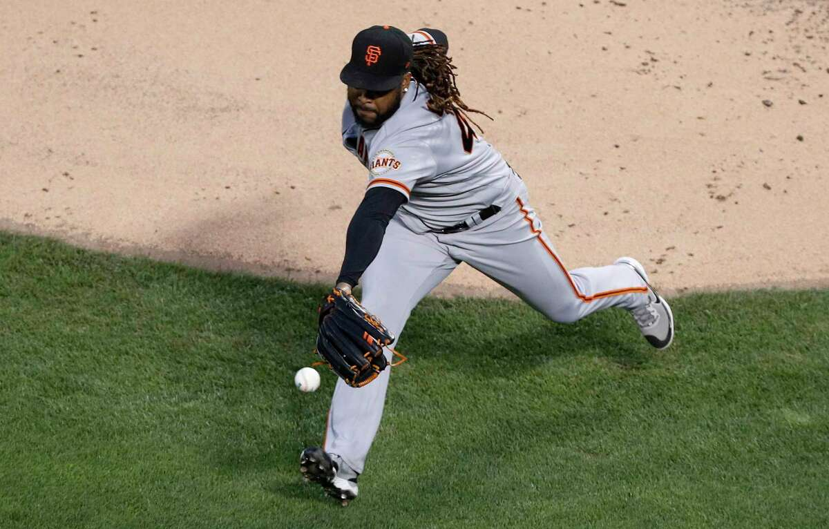 NEW YORK, NEW YORK - AUGUST 25: Johnny Cueto #47 of the San Francisco Giants can't come up with a ball hit for an infield single in the second inning by Javier Baez of the New York Mets at Citi Field on August 25, 2021 in New York City. (Photo by Jim McIsaac/Getty Images)