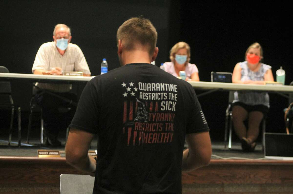A parent speaks out against the mandatory mask policy of Manistee Area Public Schools during a work study session Wednesday night in the Manistee Middle High School auditorium.