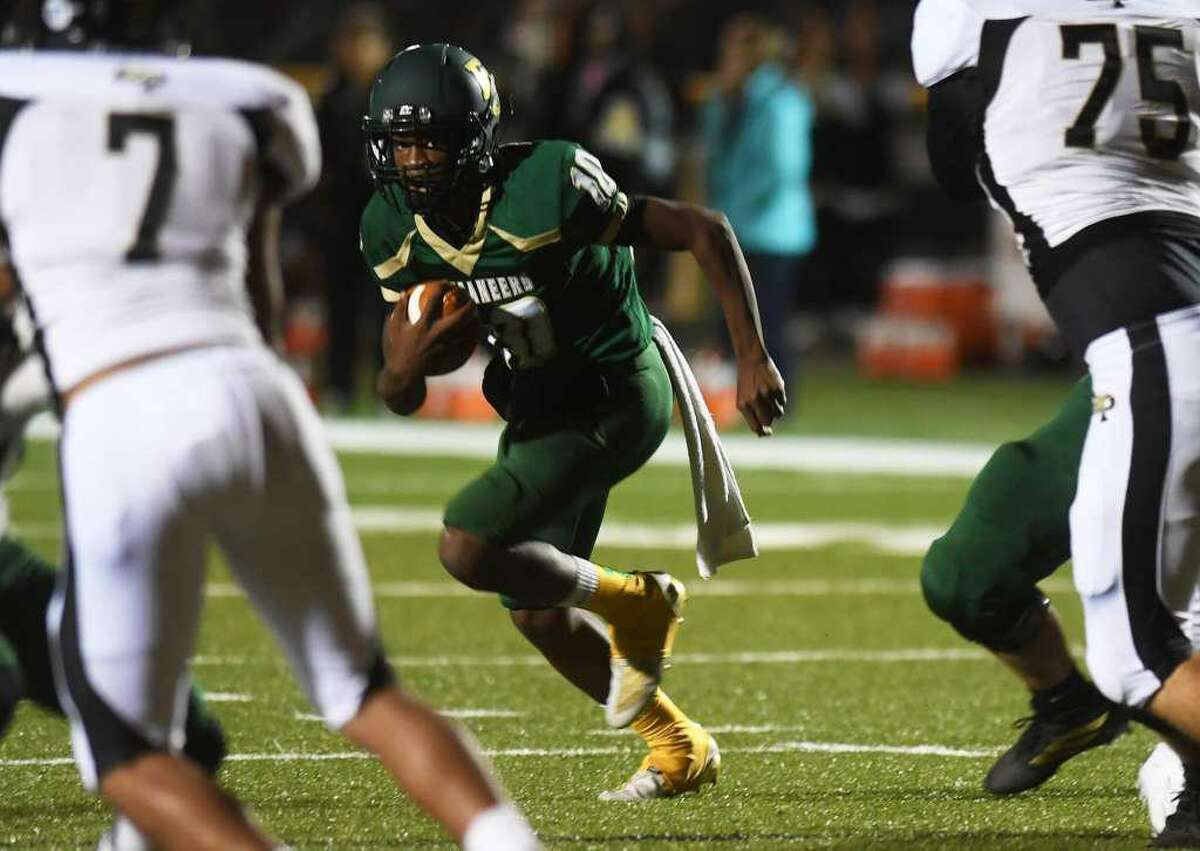 East Chambers' quarterback Jacoby Perrault runs the ball during a game against Anahauc.