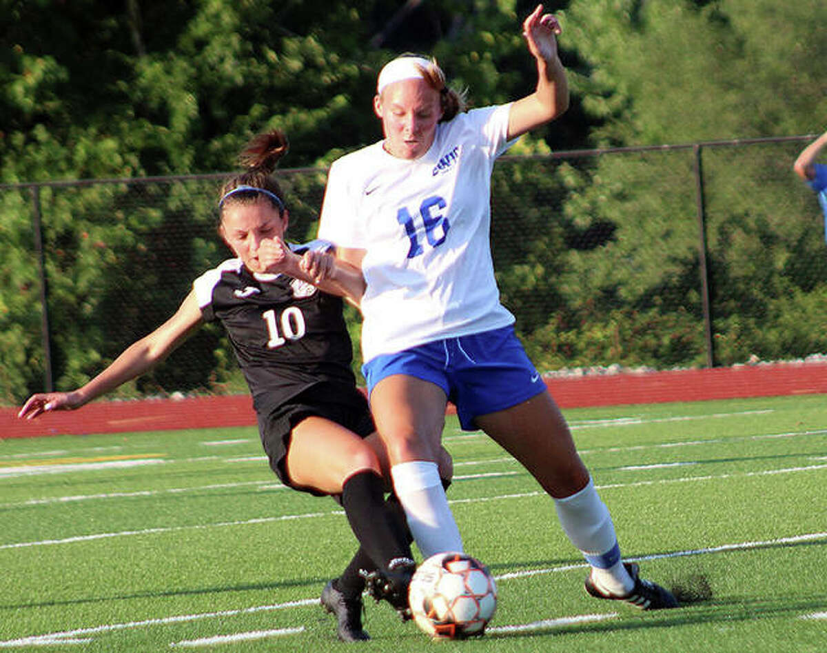 LCCC Grace Osvath (10) battles for the ball with Southwestern Illinois College's Kylie Murie Wednesday night at Belleville Althoff high School.