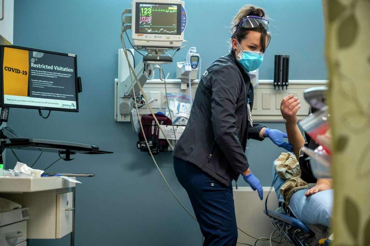 Kristen Marin, an emergency room nurse at Adventist Health Ukiah Valley Hospital, gives a patient an IV.