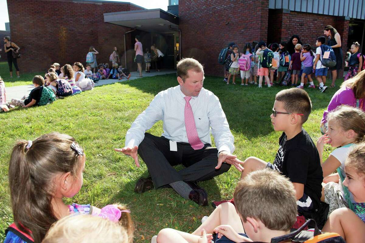 Wilton Schools Superintendent Kevin Smith talks with Miller-Driscoll students on the first day of school in 2018.