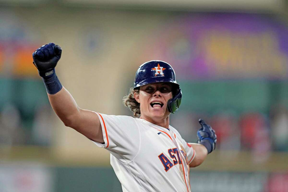 Houston Astros' Jake Meyers celebrates after hitting a walk-off game-winning fielders choice to score Alex Bregman during the 10th inning of a baseball game against the Kansas City Royals Wednesday, Aug. 25, 2021, in Houston. The Astros won 6-5 in 10 innings. (AP Photo/David J. Phillip)