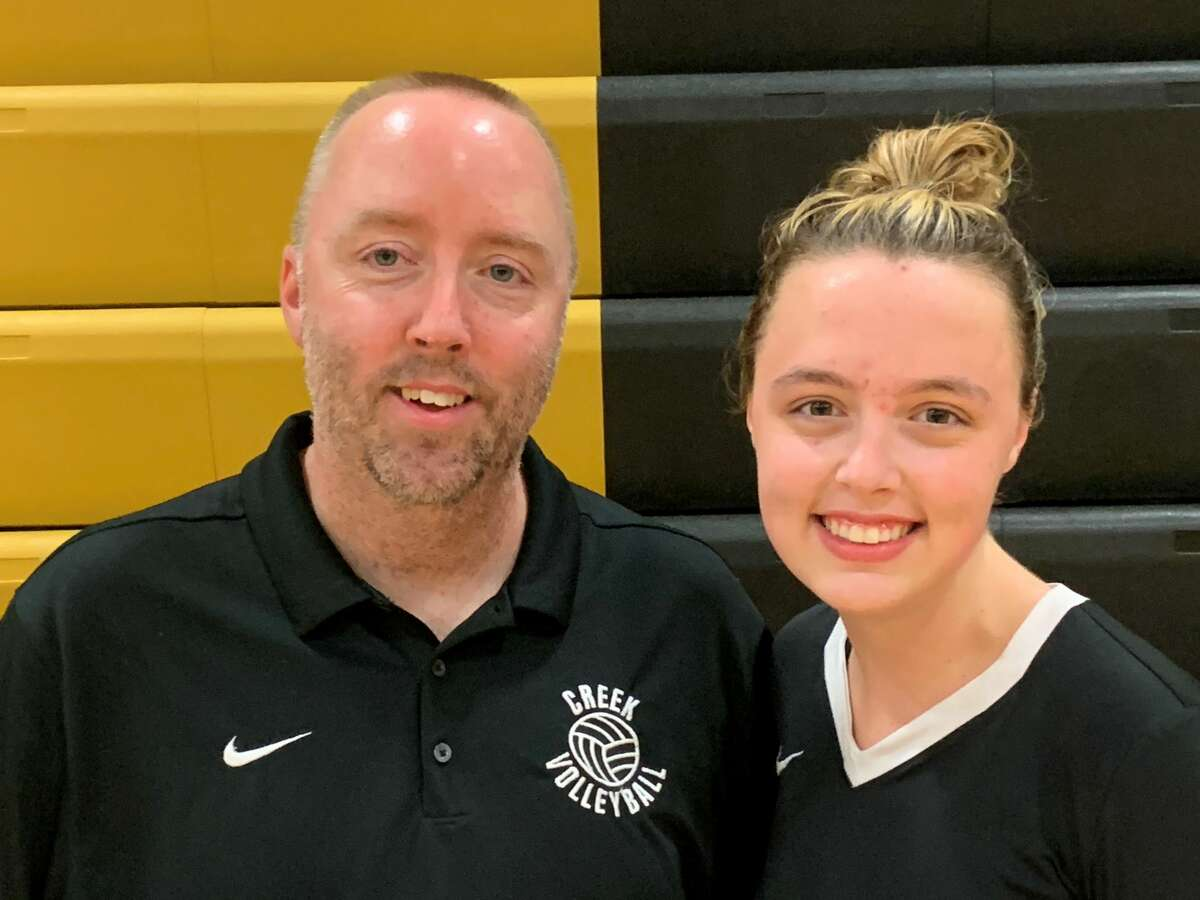 Bullock Creek's Justin Freeland and Vivian Freeland pose together following Wednesday's matches against Freeland and Meridian, Aug. 25, 2021.