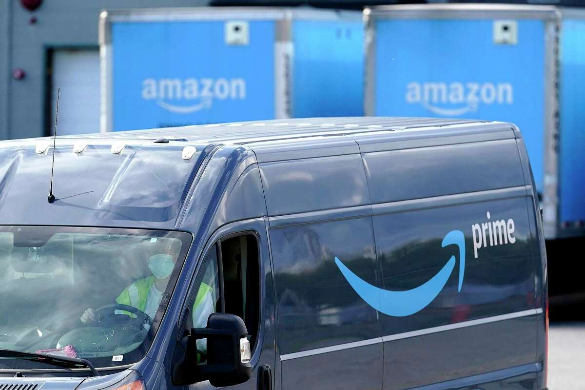 Police said first responders were dispatched to an All Hollows Road address in Plainfield, Conn., to find the woman on the ground, screaming in pain, after reportedly being hit by an Amazon delivery van - not the one photographed here - that rolled down a driveway.