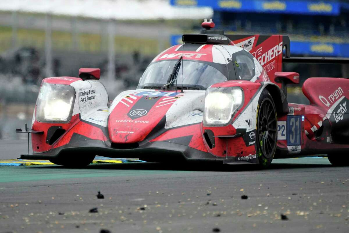 The Team WRT's Oreca 07 Gibson, right, driven by Robin Frijns of the Netherlands, Ferdinand Habsburg of Austria and Charles Milesi of France races during the 24-hour Le Mans endurance race, in Le Mans, France, Sunday, Aug. 22, 2021. (AP Photo/Francois Mori)