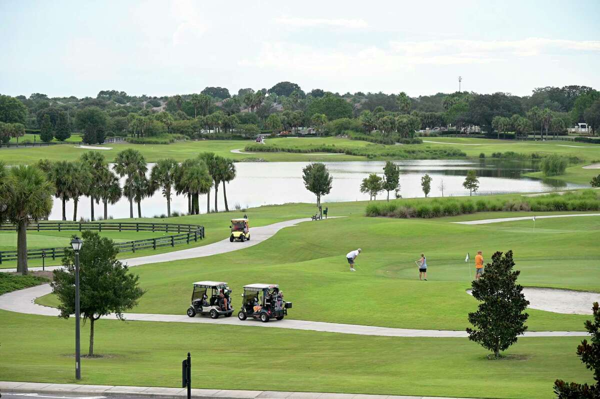 Residents golf on one of the numerous golf courses in The Villages, Fla, Aug. 12, 2021.